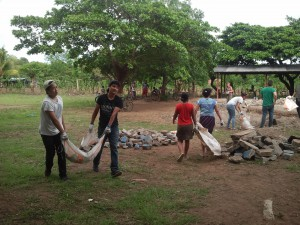 Locals and Glimpsers working together to carry the rocks away.