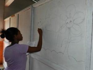 Jada sketching the wall mural