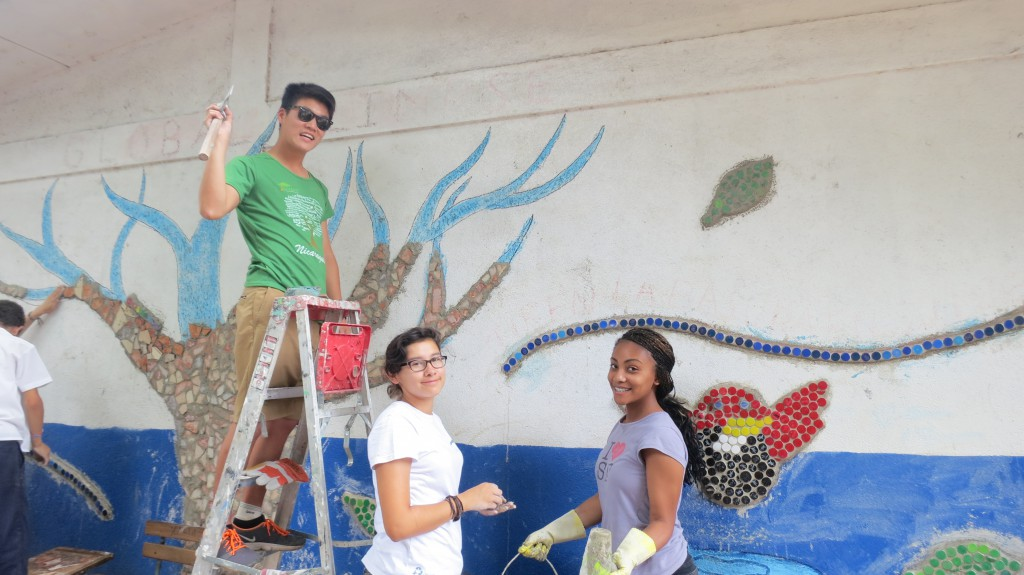 Kevin, Jazmin and Brit'ne working on the mural.