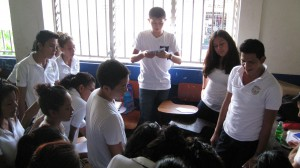David preforming a magic trick for the Nica students