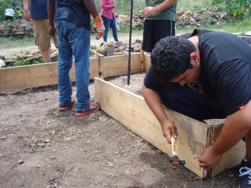 Miguel Sanchez was working hard on the herb garden.
