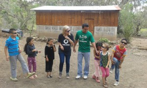 Chelsea and Denis with the kids in our community for Living on $1/Day!