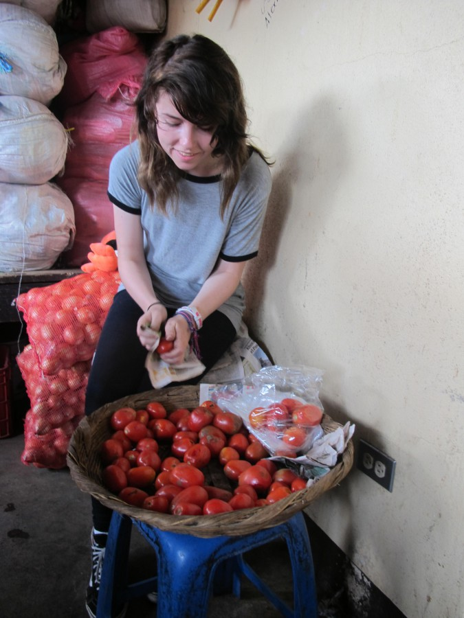 Hana cleaning tomatoes.