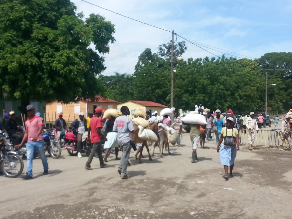 People crossing into and out of Haiti