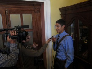 Alejandro getting interviewed for TV