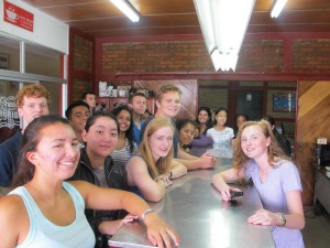 The group at the coffee mill excited to learn how to classify coffee.
